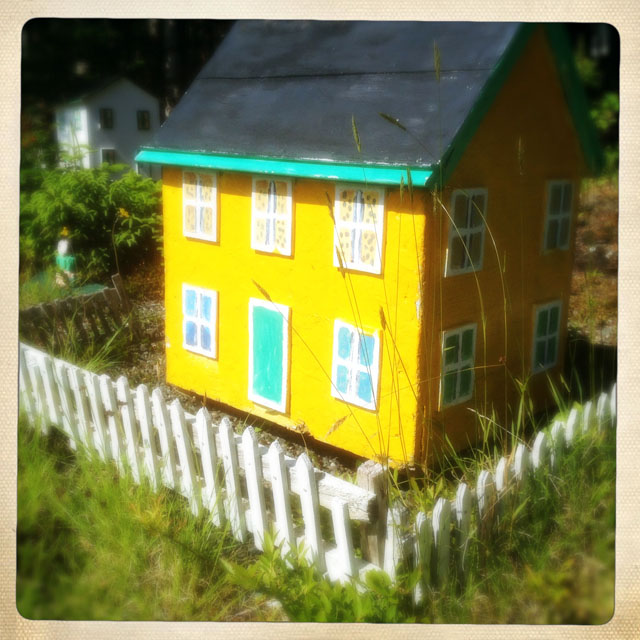 Yellow house with picket fence