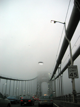New York tower of george washington bridge in fog