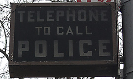 police phone sign close-up