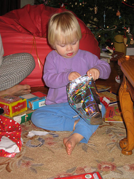 Zoe opening a present