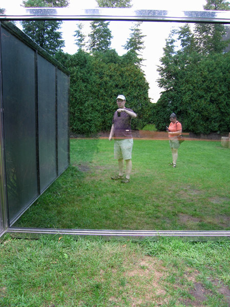 Ann and I in the Two-way Mirror Punched Steel Hedge Labyrinth, by Dan Graham