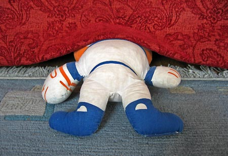 Mr. Met under the couch