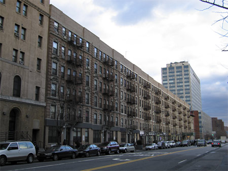 This row of apartment buildings along 135th Street, which are part of Section 8 housing, will get a green makeover starting next month.
